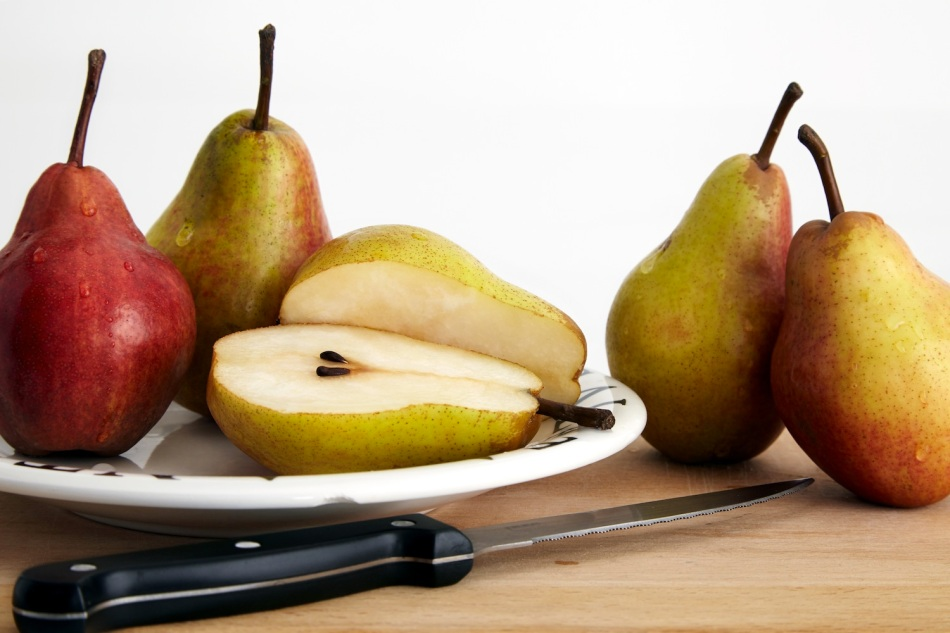 Pears on plate, one cut in half