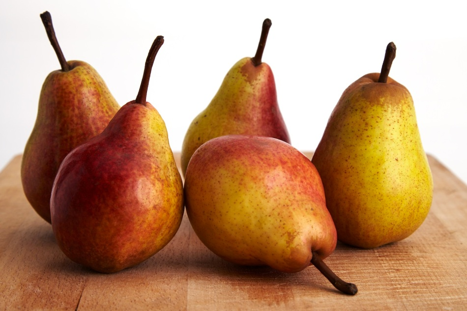 Pears on wood board